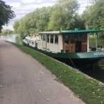 Green barge named patricia with a union jack flag